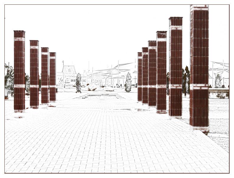 Allée pavée bordée de colonnes rouges